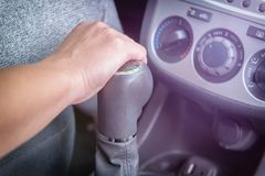 Hand on gear shift lever Stock Photo