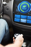 Hand with gearshift and car eco mode on screen Royalty Free Stock Photography
