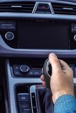 Hand on the gearshift lever. Of the car with a shallow depth of field royalty free stock photography