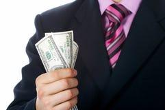 Hand, Gelddollar USA stockfotografie