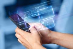 Hand genom att använda för informationsdatabas om telefon begrepp royaltyfria bilder
