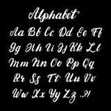 Hand geschreven kalligrafiealfabet in kleine letters en in hoofdletters Royalty-vrije Stock Foto's