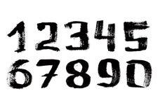 Hand geschriebene schwarze Tintendigits Stockfoto