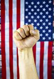 Hand gesture against the background of the flag of the United States of America stock photo