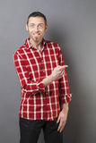 Hand gesture concept for excited 40s man pointing finger Royalty Free Stock Image