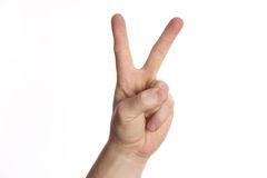 Hand gesture peace sign on isolate white. Background stock photography
