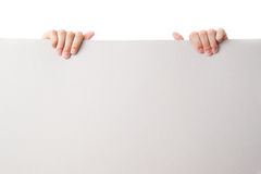 Hand gesture with sheet of blank paper Stock Photos