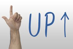 Hand gesture show up. UP text with an up arrow. hand sign upstairs. Hand pointing upwards on whiteboard with text Up. Hand gesture show up. UP text with an up Royalty Free Stock Photography