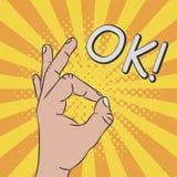 Hand gesture - sign OK. Comic illustration in pop art style at sunburst background with dot halftone effect. Vector. stock illustration