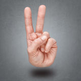 Hand gesture of victory and peace. Royalty Free Stock Image