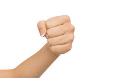Hand gesture, woman clenched fist, ready to punch. Hand gesture. Woman clenched fist, ready to punch,  on white, close-up, copy space Royalty Free Stock Images