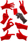 Hand gestures in a red and black glove Stock Images