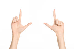 Hand gestures theme: the human hand shows gestures isolated on white background in studio Stock Photos