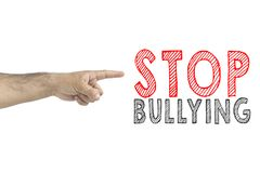 Hand gesturing with index finger to inscription: Stop bullying stock image