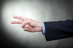 Hand gesturing peace sign Royalty Free Stock Image