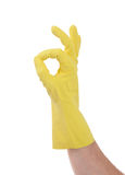 Hand gesturing with yellow cleaning product glove Stock Image