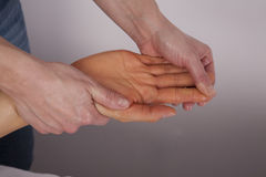 Hand getting massage Stock Image