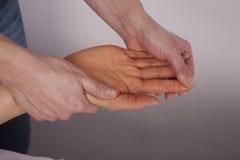Hand getting massage Stock Image