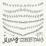 Hand gezeichnete Weihnachtsdekorative Elemente, -gekritzel und -grenzen Lizenzfreies Stockbild