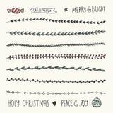Hand gezeichnete Weihnachtsdekorative Elemente, -gekritzel und -grenzen Lizenzfreies Stockfoto