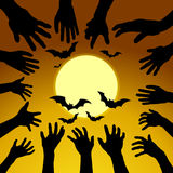 Hand ghosts rising from the grave on Halloween. Royalty Free Stock Images