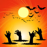 Hand ghosts rising from the grave on Halloween. Stock Photography
