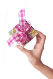 Hand and gift. In isolate background stock images