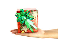 Hand and gift. Over white background Royalty Free Stock Photo