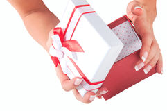 Hand with a gift Royalty Free Stock Photography
