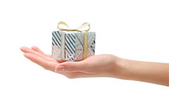 Hand with gift box. On a white background Royalty Free Stock Images