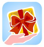 Hand and gift box royalty free stock photography