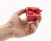 Hand with gift box Stock Images