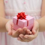 Hand with gift box Stock Photo