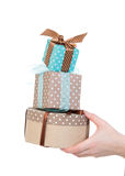 Hand with gift boxes in woman hand for christmas or birthday pre Stock Image