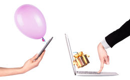 Hand with a gift and laptop Stock Photo