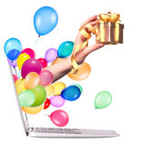 Hand with a gift and laptop Royalty Free Stock Photos