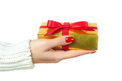 Hand and gift over white background.  Royalty Free Stock Photo