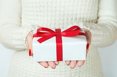 Hand and gift over white background.  Royalty Free Stock Images