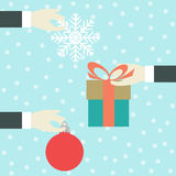 Hand with a gift Stock Images