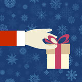 Hand with a gift Royalty Free Stock Images