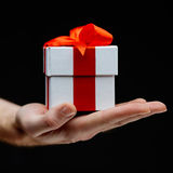 Hand with giftbox Royalty Free Stock Image