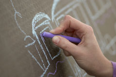Hand of girl. A girl draws a chalk Royalty Free Stock Photos