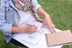 Hand of Girl Artist Makes Sure Sharp Pencil Strokes on Album Pag. Talented Young Woman Handles Details ,obscures Hair in Picture. Sketch Executed Ordinary Pencil Royalty Free Stock Image