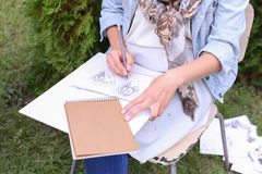 Hand of Girl Artist Makes Sure Sharp Pencil Strokes on Album Pag. Talented Young Woman Handles Details ,obscures Hair in Picture. Sketch Executed Ordinary Pencil Stock Image