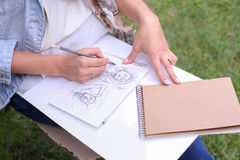 Hand of Girl Artist Makes Sure Sharp Pencil Strokes on Album Pag. Talented Young Woman Handles Details ,obscures Hair in Picture. Sketch Executed Ordinary Pencil Stock Photography