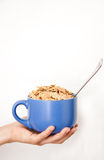 Hand girl with a bowl of cereal in hand Royalty Free Stock Photo