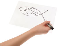 Hand girl drawing a Christian fish symbol.  Stock Photography