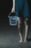 Hand girl holding a Halloween bucket. Royalty Free Stock Image