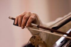 Hand girl playing cello Stock Photos