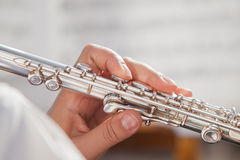 Hand girl playing flute Stock Photos